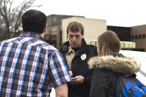 Officer John Prentice talks with Kyle Smith and Jami Daniel on campus. JASON HOWELL | THE HARBINGER