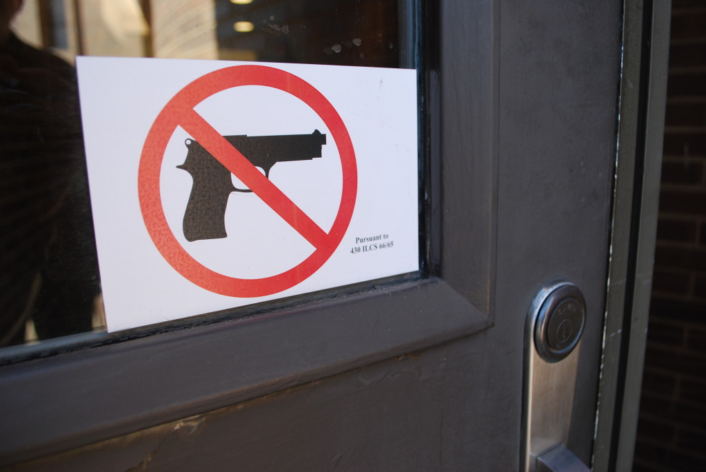 All of the college's entrances now show signs that reflect the new weapons on campus policy. REID HARMAN | THE HARBINGER