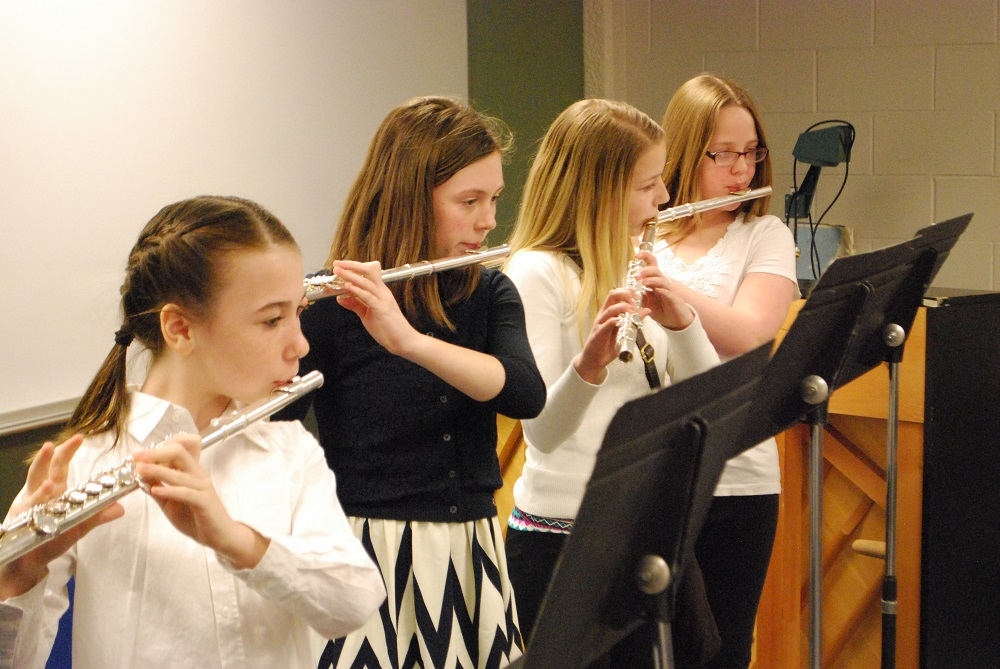 """These four girls (left to right, Brooklyn McGahey, Emma Wolfe, Payton Salsman and Kaitlyn Anno) from Galesburg Dist. 205 performed a well-received rendition of """"Sheperd's Hey"""" as a flute quartet."""