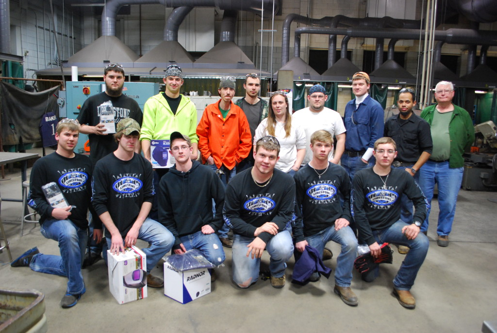 The winners of the AWS welding competition (back row, college division; front, high school division)  REID | HARMAN