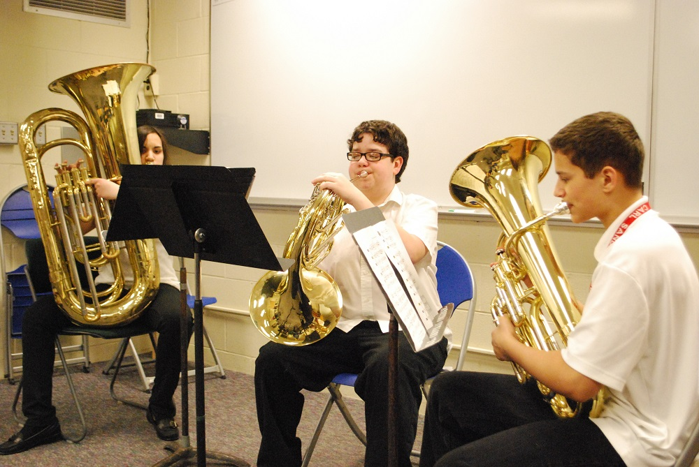 """Galesburg Dist. 205 students (left to right) Kendra Hossain, Nathan Laake and Austyn White perform """"Rio by Night"""" as a brass ensemble."""