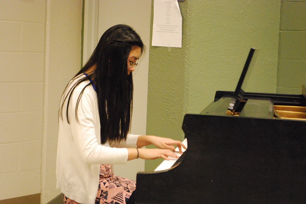 Dunlap Valley Middle School student Taylor Wen plays a beautiful piano solo. REID HARMAN | THE HARBINGER