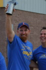 Michael Boyd celebrates after his team won the ICC employee softball game in fall 2013.