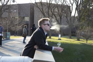 ICC student Nick Borton, enjoying a cigarette. LAUREN MARRETT | THE HARBINGER
