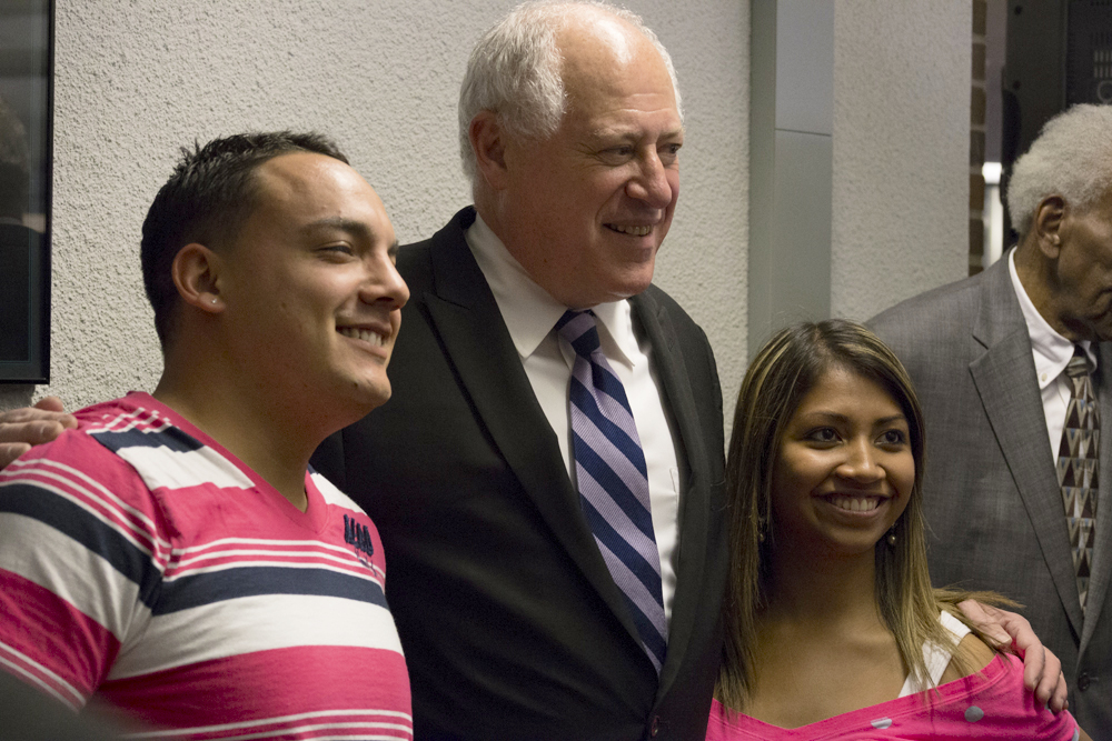 Dozens of ICC students and employees got their photos taken with the governor after his presentation. LAUREN MARRETT | THE HARBINGER