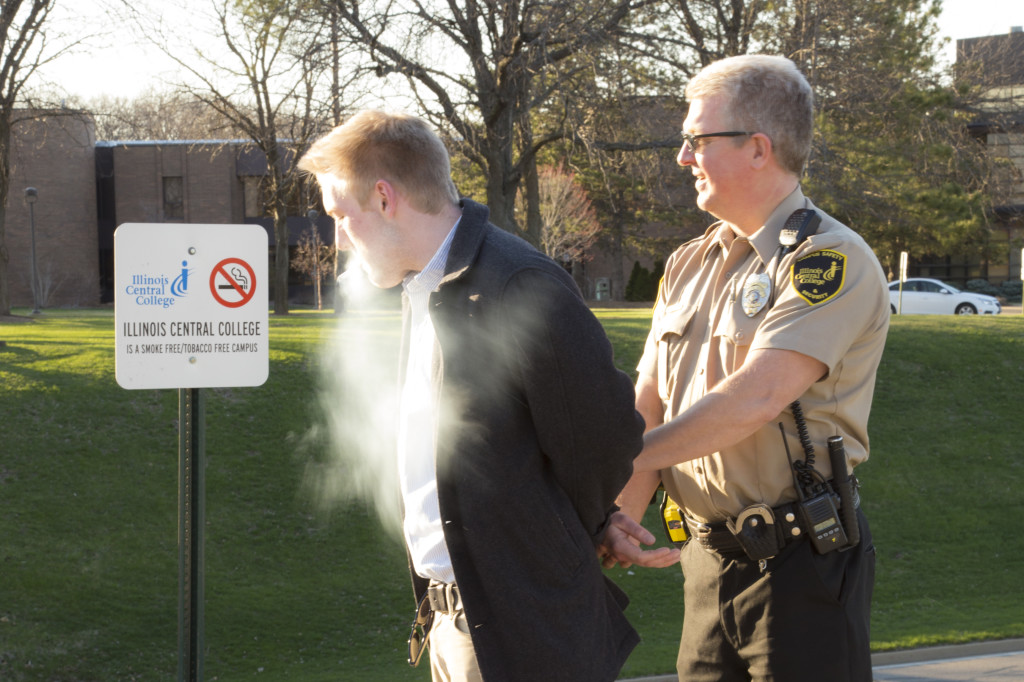 This is a dramatitization of what is likely to be the new level of tolerance of smoking on campus LAUREN MARRETT | THE HARBINGER