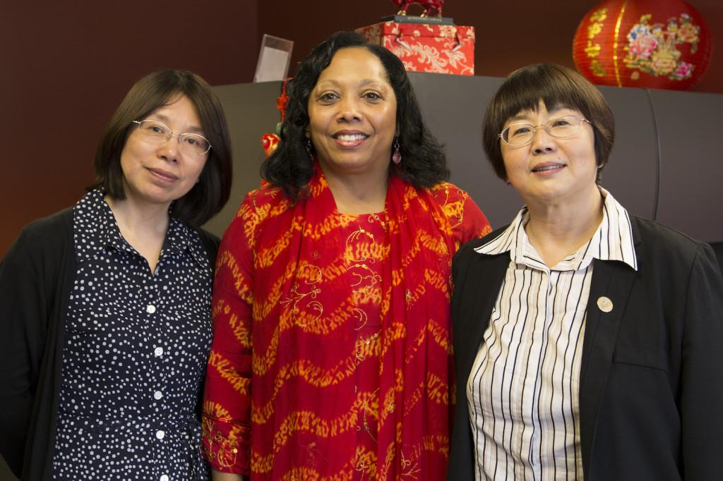 Rita Ali, ICC's vice president of diversity, stands between ICC visiting professor Shufang Liu, left, and Xiamen Huaxia's college president Xiaoru Wang, right. LAUREN MARRETT | THE HARBINGER