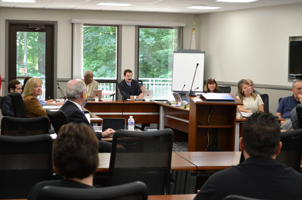At its June 21 meeting, the ICC board of trustees approved an initial FY15 budget, but a revised one was needed in August after a drop in state funding. REID HARMAN | THE HARBINGER