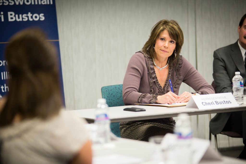 Rep. Bustos listens to the concerns of ICC student Dari Thompson (foreground) regarding the Pell Grant system. MARK NYCZ | THE HARBINGER