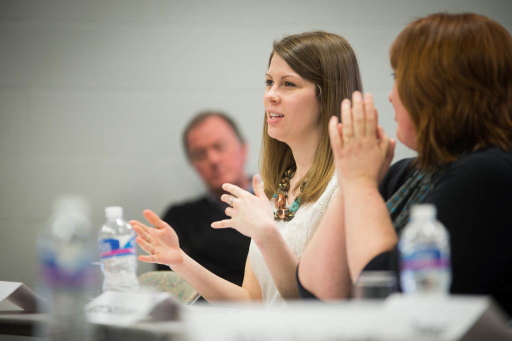 ICC employee Jill Kern, who was very recently a student herself, spoke with Rep. Bustos on possible Pell Grant improvements. MARK NYCZ | THE HARBINGER