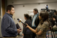 ICC alum Thomas Aguilar speaks to a local news crew after the conference. Photo courtesy ILLINOIS CENTRAL COLLEGE.