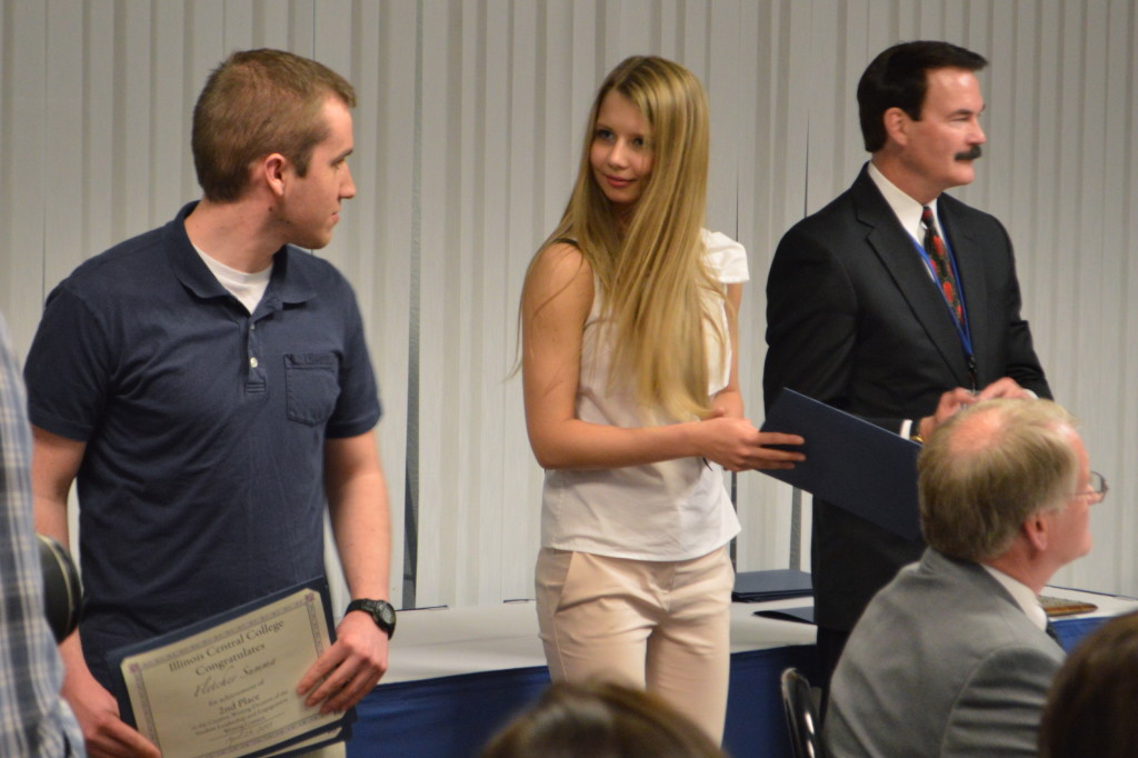 As his last act as president, Erwin (right) stood with students as they were recognized at Student Recognition Evening. REID HARMAN | THE HARBINGER